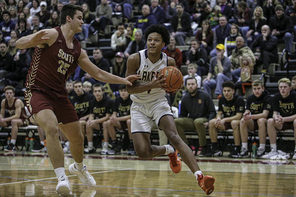 Prior Lake's Tyree Ihenacho (right) took the ball to the basket, looking for a way around Lakeville South's Riley Mahlman. Photo by Mark Hvidsten, SportsEngine