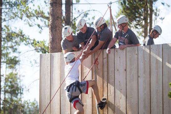 "Centennial players help a teammate over the wall during the ""Pioneer Challenge"" at the Devil's Thumb Ranch in Tabernash, Colo. Photo: C. Wenthur Photography"
