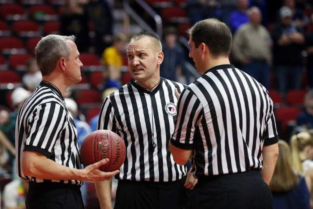 Officials on the basketball court