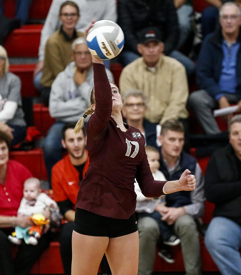 Senior outside hitter Madeleine Lemkuil's 12 kills helped Southwest Christian win 25-23, 25-21, 25-23, giving Mayer Lutheran its first conference loss of the season on Thursday night. Photo by Cheryl A. Myers, SportsEngine