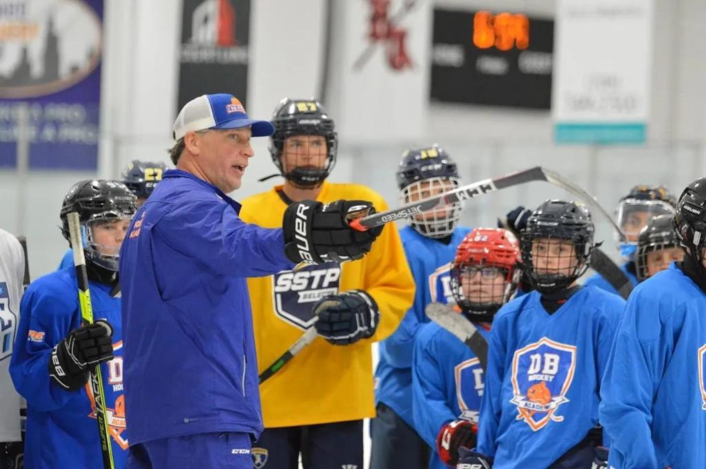 Coach Doug explaining a drill to players