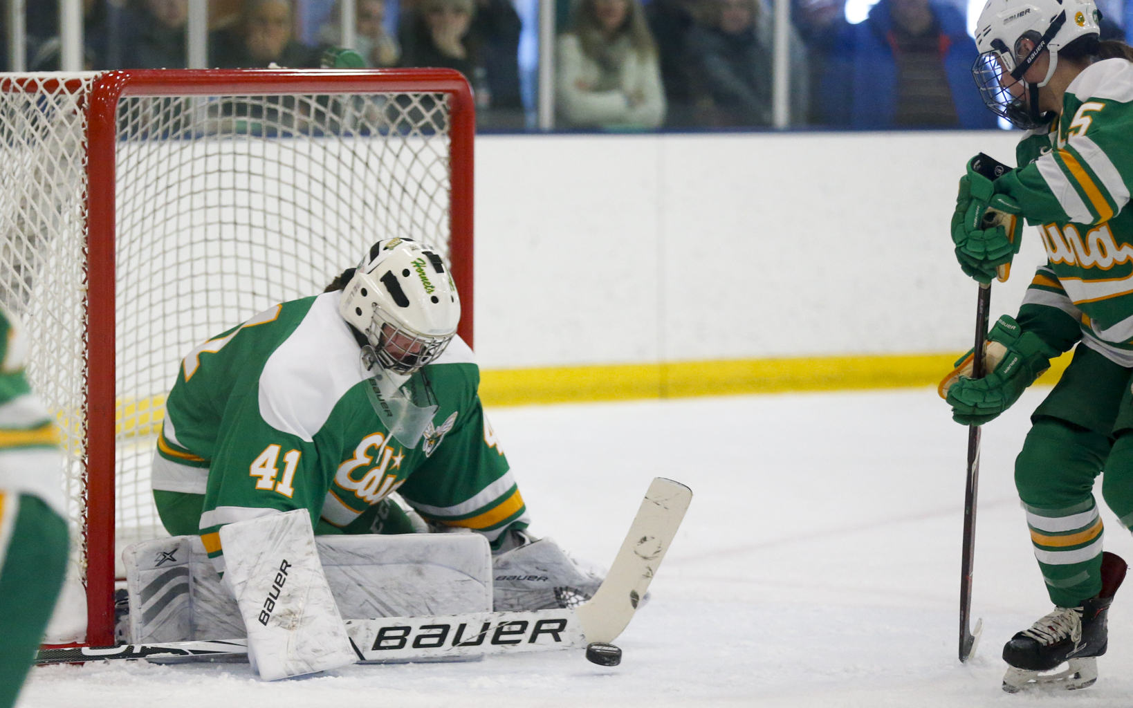 Edina's Uma Corniea (41) makes a stick save against Blake Saturday afternoon. Corniea had 22 saves in the Hornets' 4-1 victory over the Bears at Blake Ice Arena. Photo by Jeff Lawler, SportsEngine
