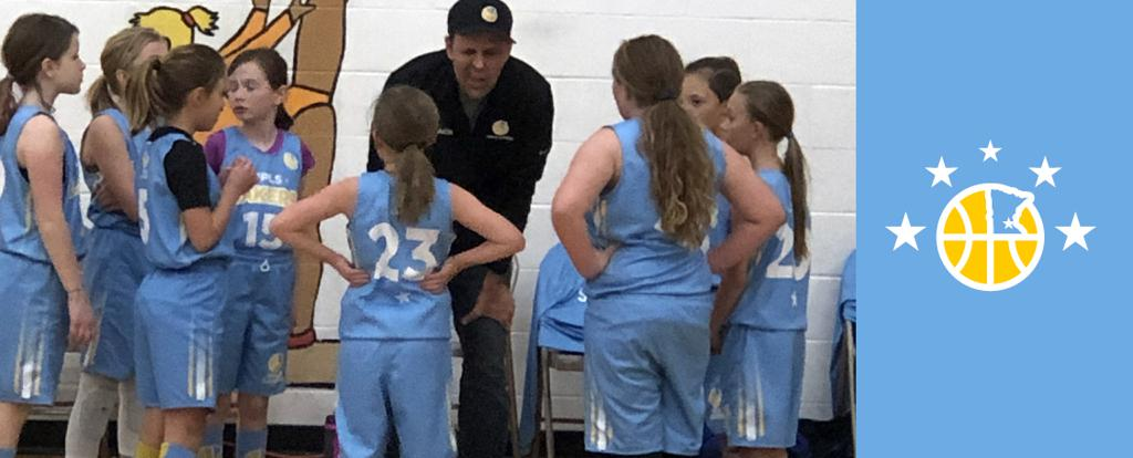 Minneapolis Lakers Girls 5th Grade Blue in a team huddle during a time out at Rockford Girls Showcase tournament in Rockford, MN