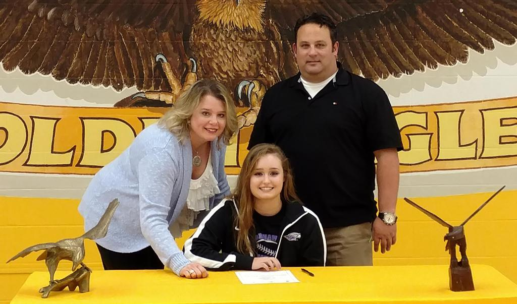 Alexis Addante of Jacobs High School with her parents Diana and Chris signs her Letter of Intent to play softball at the University of Wisconsin - Whitewater.