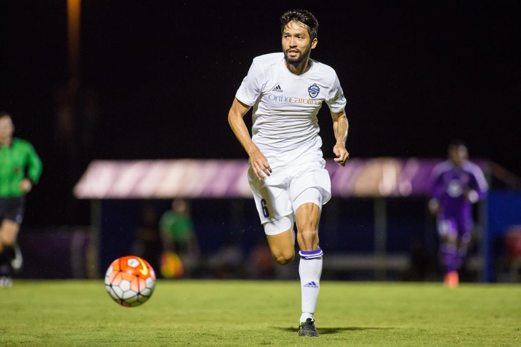 Jun Marques-Davidson runs with the ball during a regular season match of Charlotte Independence versus Orlando City B