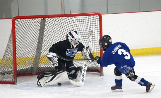 Brendan Clemens (Waconia) of RPM Blue scores one of his six goals last Sunday against RPM Black. Credit: Courtesy YHH.