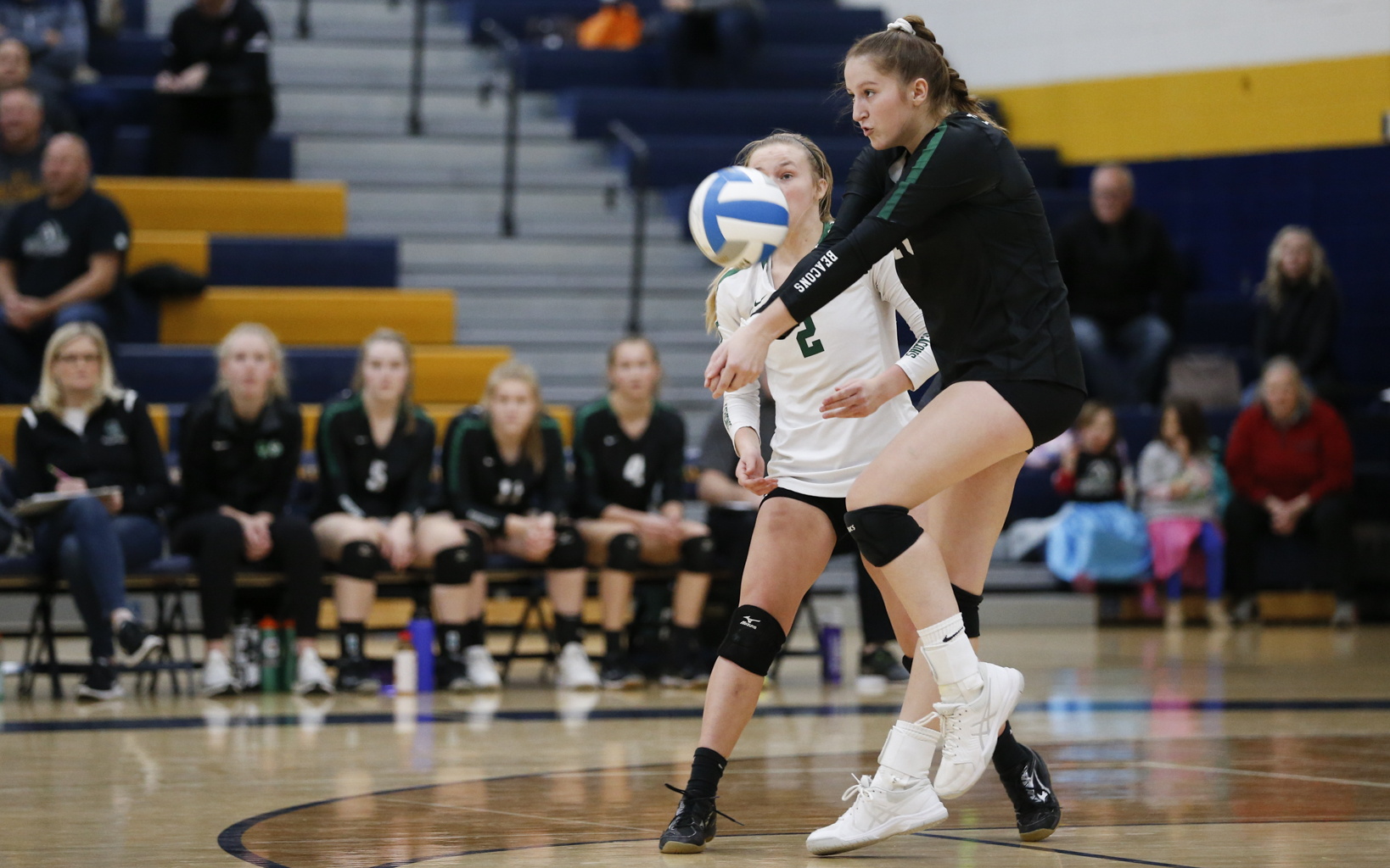 Concordia Academy's Sydney Pelzer (10) returns a serve against Holy Angels. The Beacons defeated the Stars in three sets (25-18, 25-20, 25-21). Photo by Jeff Lawler, SportsEngine