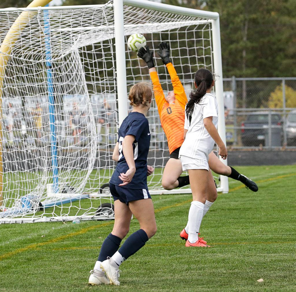 Paige Kalal (5) watches the ball slip past goalkeeper Sarah Martin for a goal in the second half. Photo by Cheryl A. Myers, SportsEngine