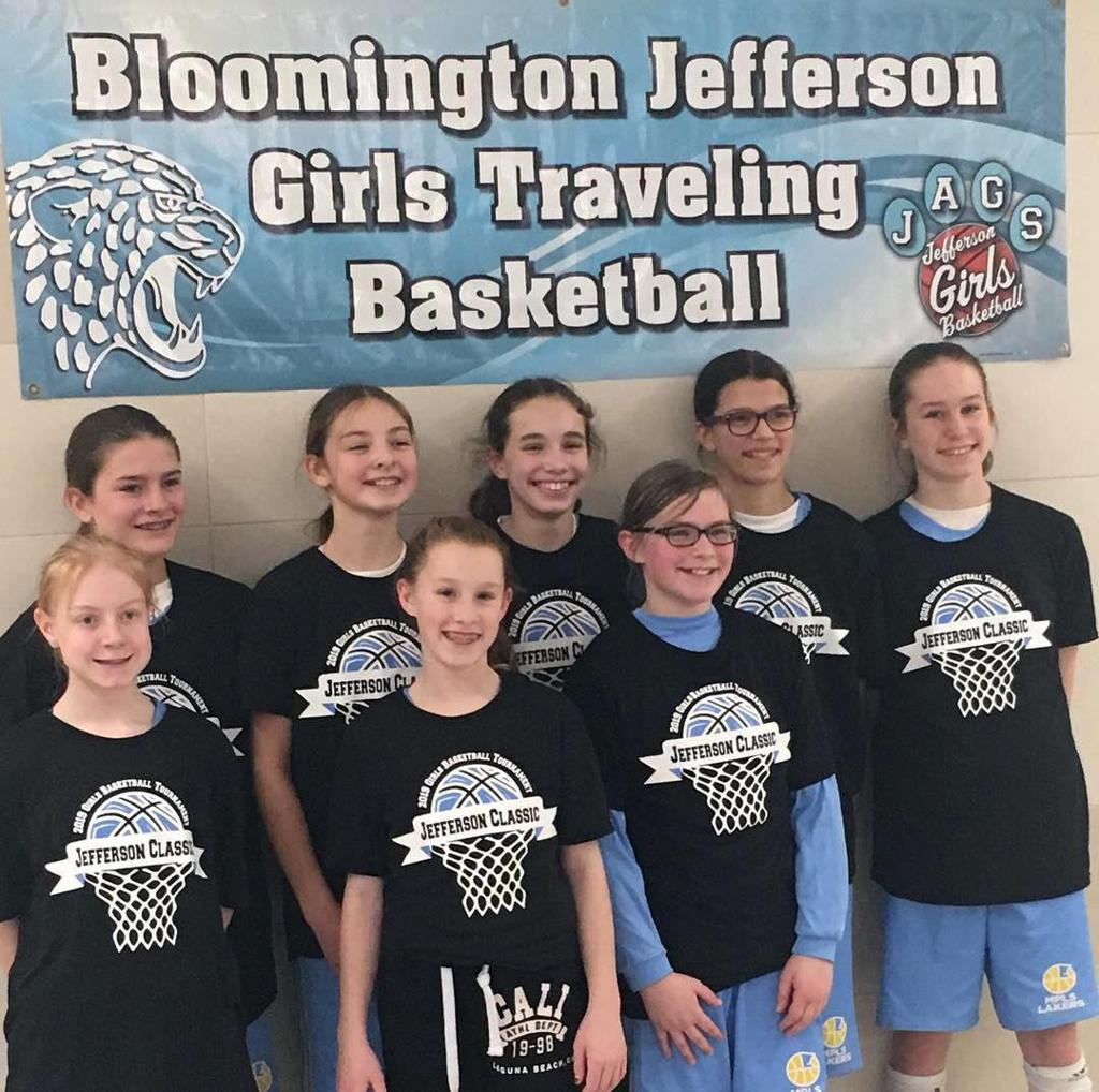 Minneapolis Lakers Girls 6th Grade Gold pose with their t-shirts after taking 3rd Place at the Jefferson Classic Girls Basketball tournament in Bloomington, MN