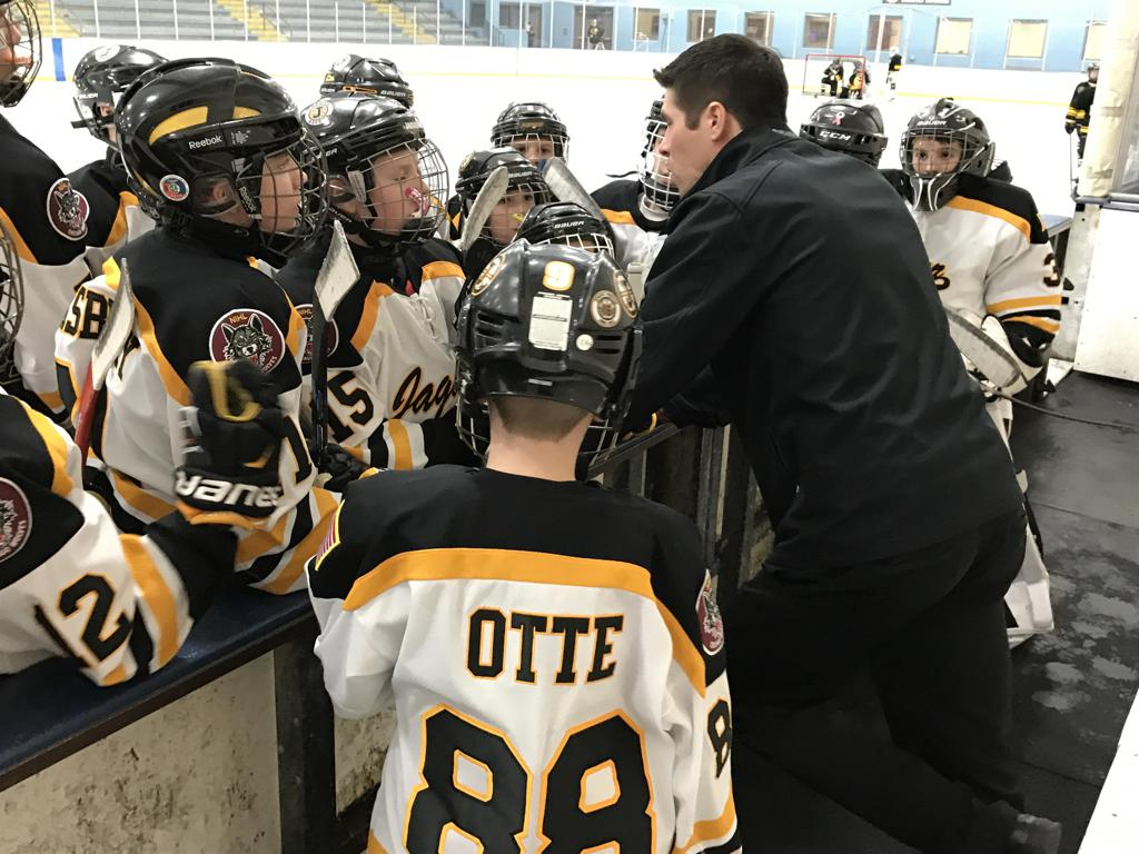 Peewee 1 Coach Ryan Schuman gives him team a pep talk before the game with the Crystal Lake Yellowjackets on Sunday. Brandon Otte, front, was honorary coach for the game.