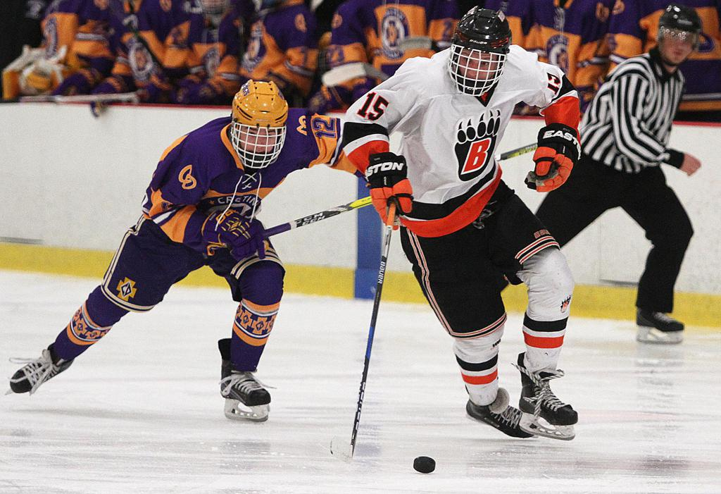White Bear Lake forward Austin Carroll carries the puck into the offensive zone during the second period Tuesday night. Photo by Drew Herron, SportsEngine