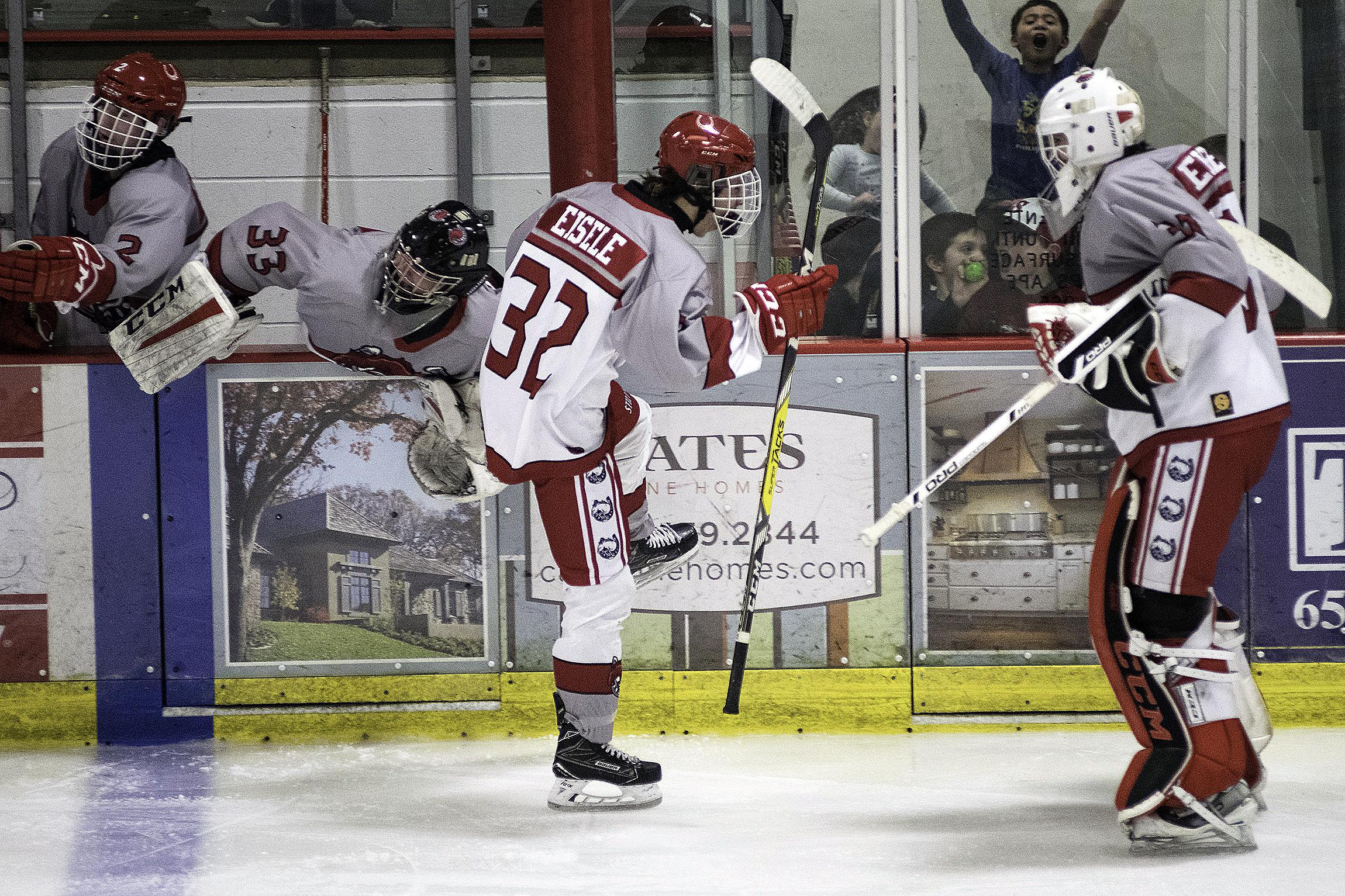 Brothers Adam Eisele (left) and Seth Eisele celebrate after Adam's third-period goal against White Bear Lake. Photo by Spencer St. Dennis (www.spencerstdennisphotography.squarespace.com)
