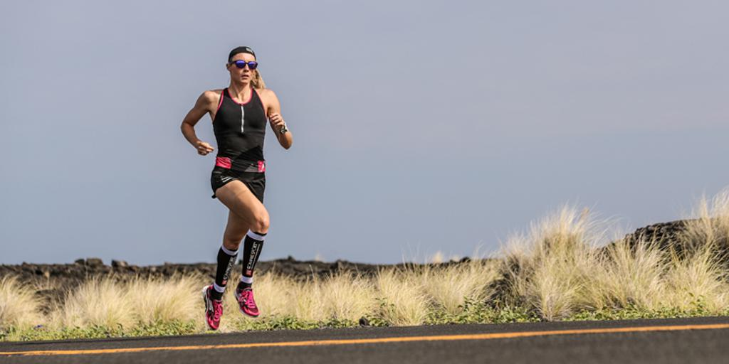 Triathlete running wearing compression socks