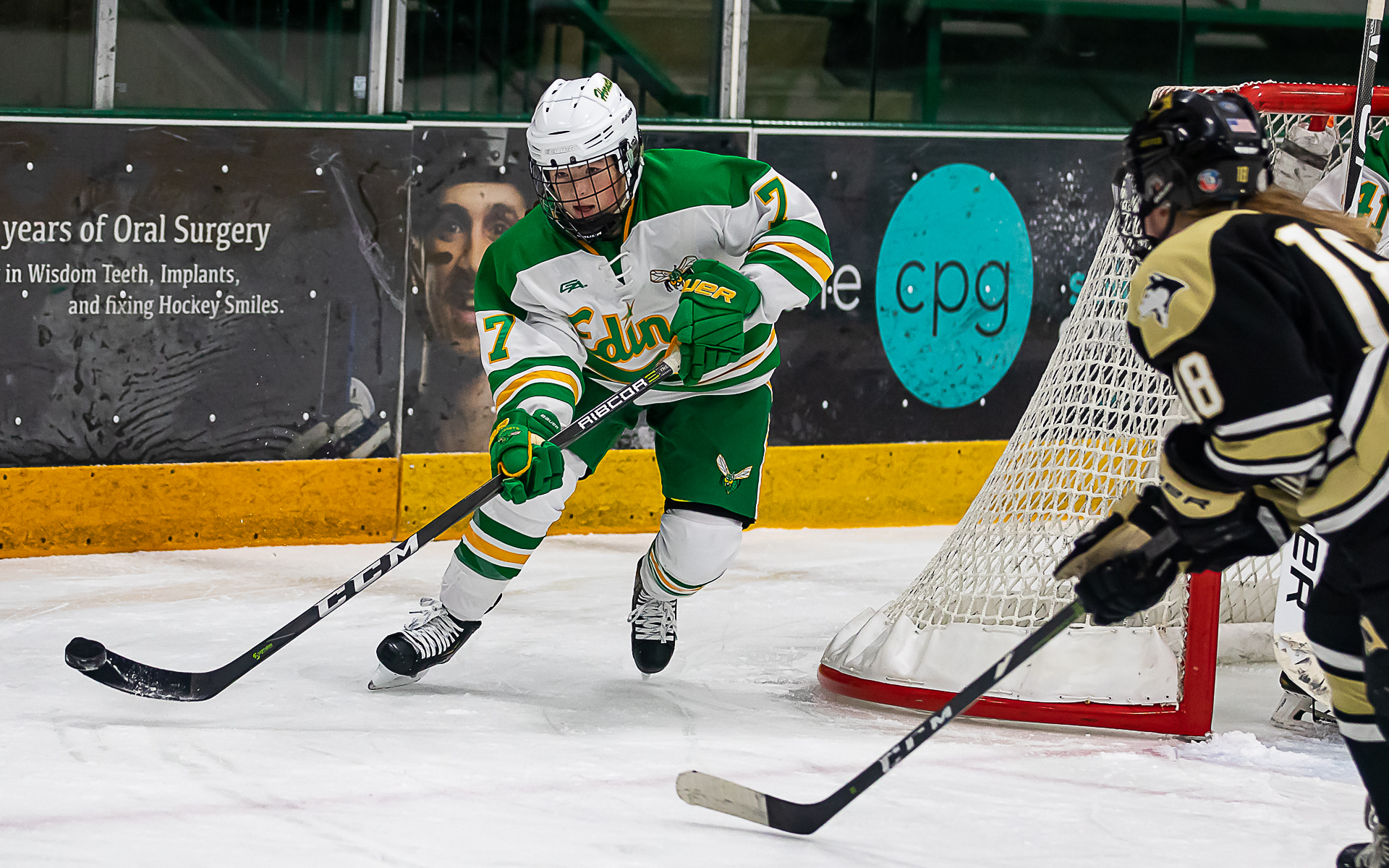 Edina junior defender Lily Hendrikson breaks the puck out against visiting Andover. The Huskies defeated the Hornets 1-0 Thursday night. Photo by Gary Mukai, SportsEngine
