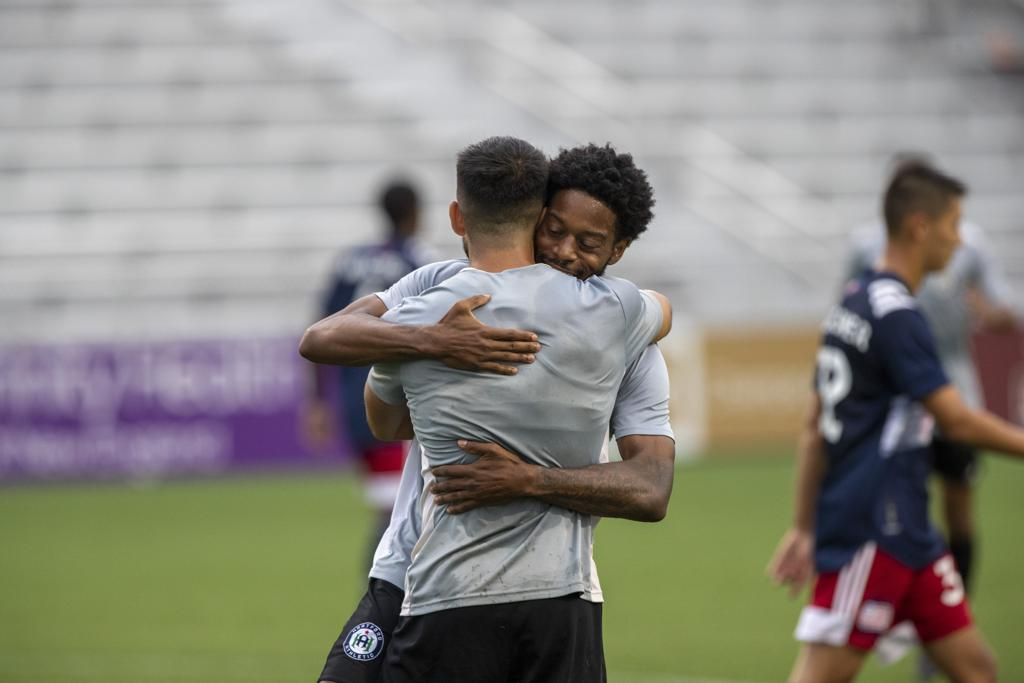 Alex Dixon and Cheno Guzmán celebrate after the two connected for the first goal of the evening