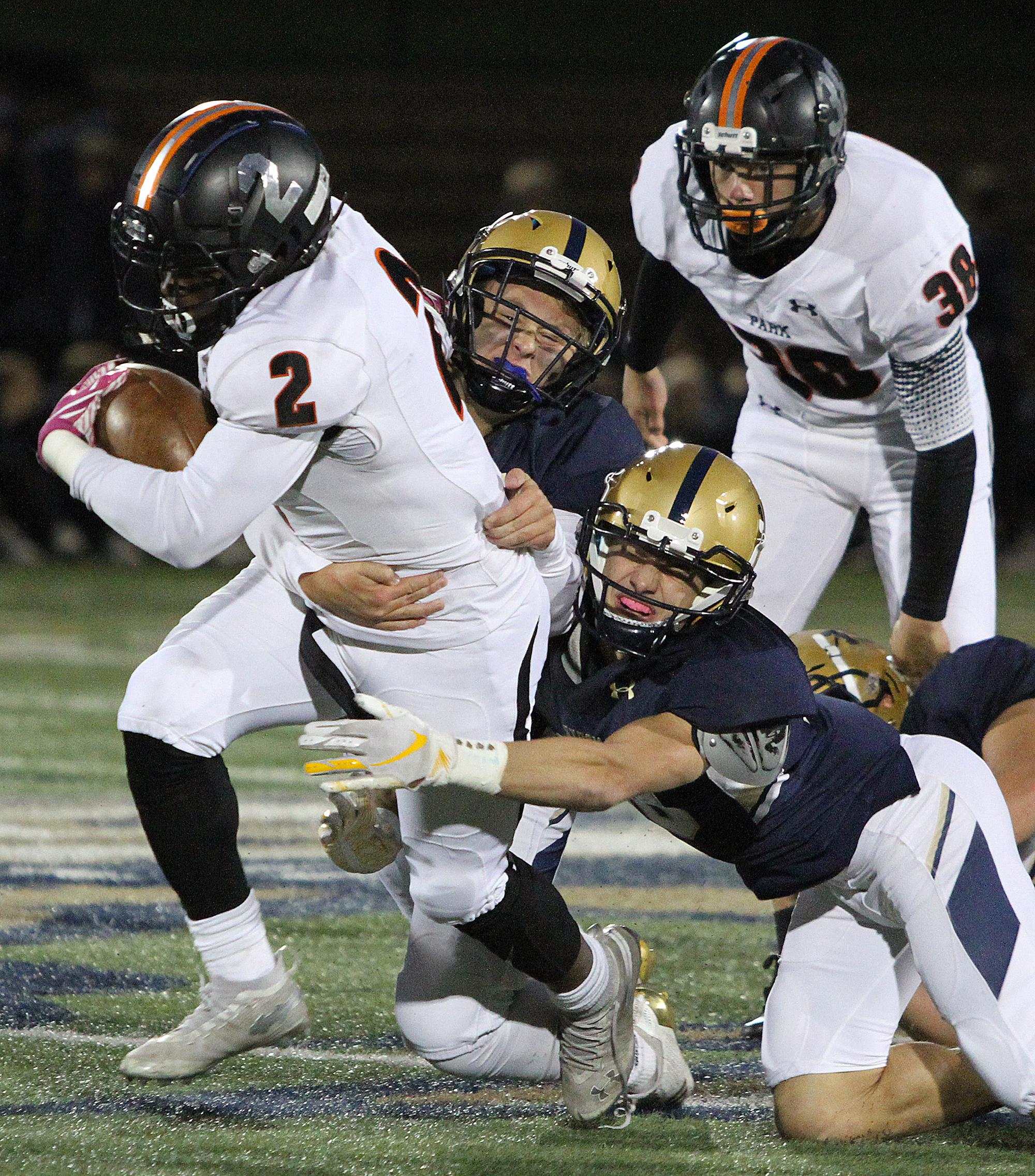 St. Louis Park senior Tobyous Davenport fights off Chanhassen tacklers near midfield in the first half Friday. Photo by Drew Herron, SportsEngine