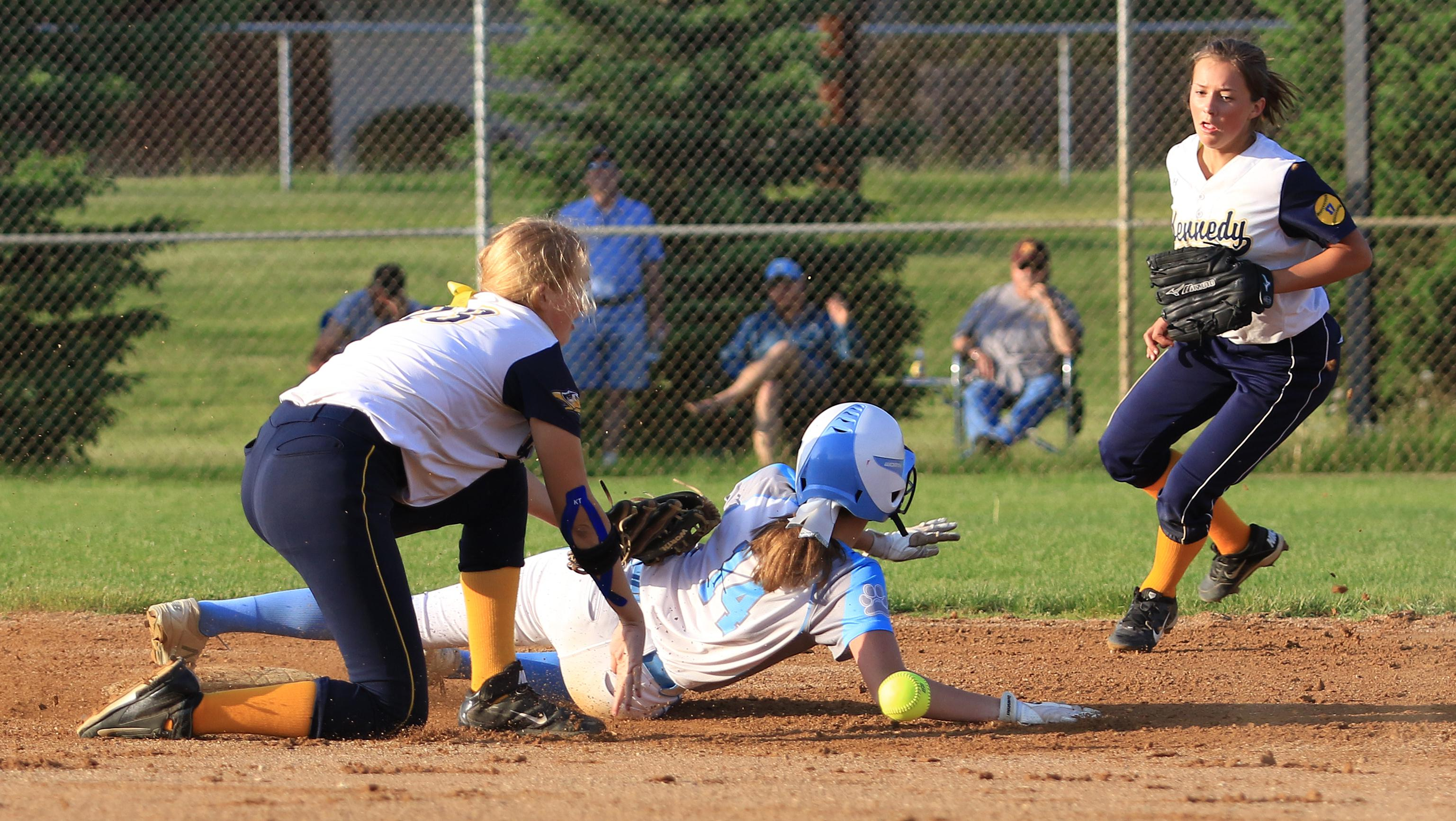 Jefferson's Lizzy Walker slides into second base on a missed catch for a stolen base.  Walker would score twice in the Jaguars 3-0 defeat of city rival Bloomington Kennedy.  Photo by Cheryl Myers, SportsEngine