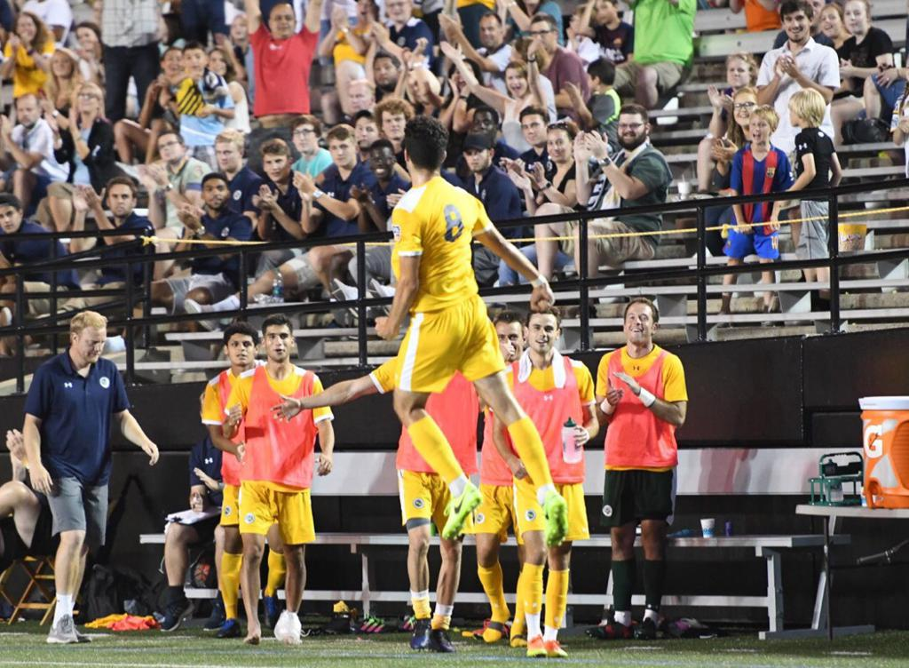 Alec Stoiljkovic celebrates his bending free kick goal