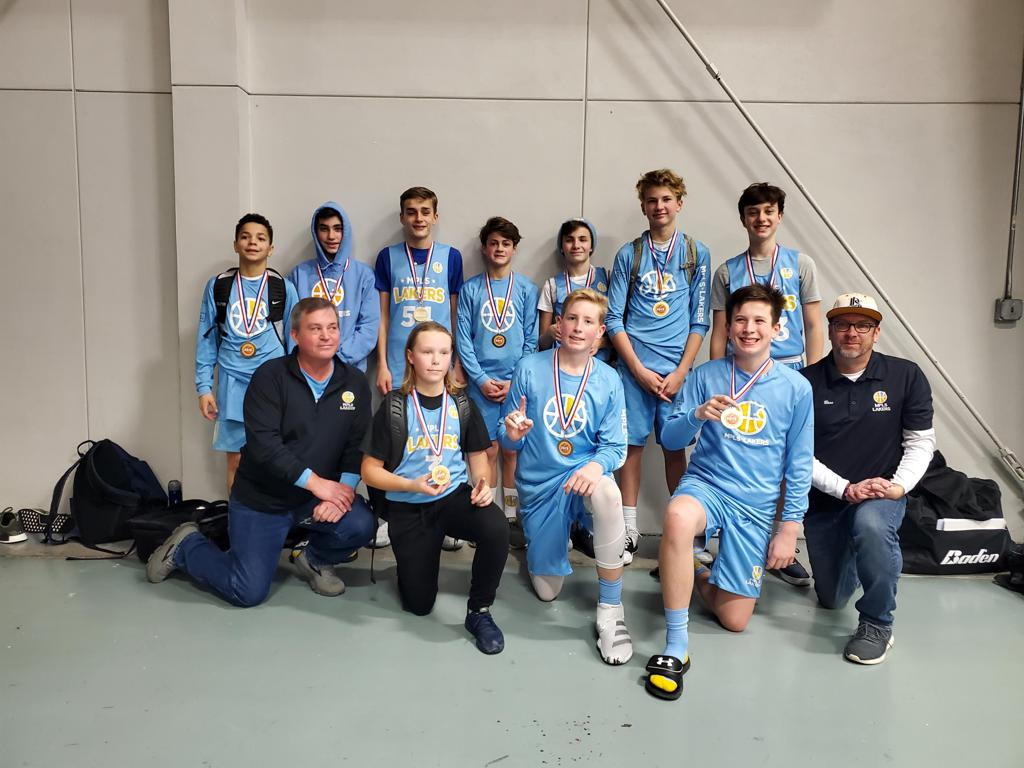 Minneapolis Lakers Boys 8th Grade Blue pose with their Medals after becoming the Champions at the Concordia Golden Bears Classic tournament in St Paul, MN