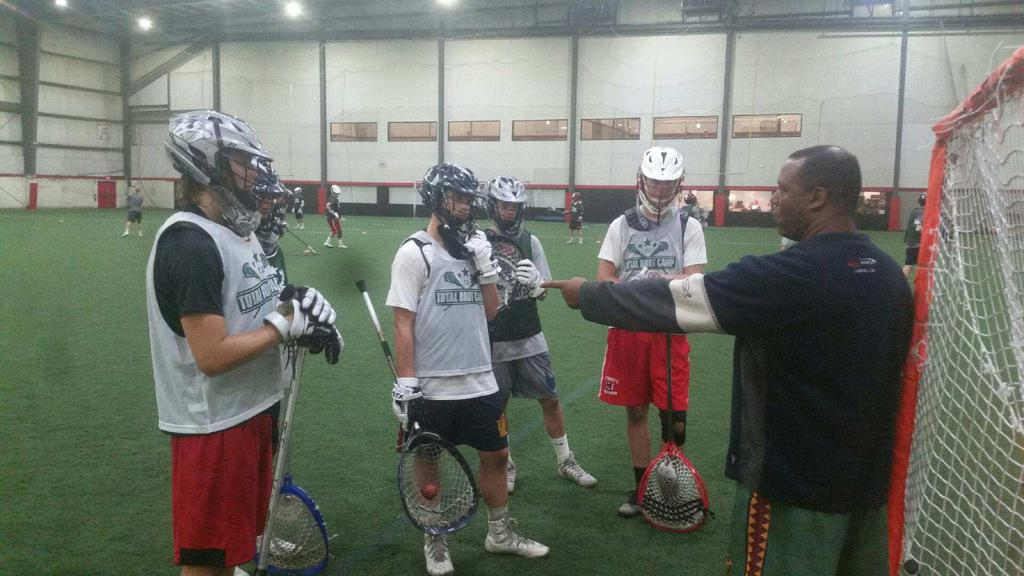 Coach Hicks talking with the goalies