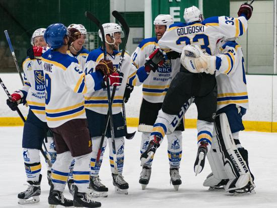 RBC celebrates its Da Beauty League title on Wednesday night at Braemar Ice Arena. Credit: Spencer St. Dennis.