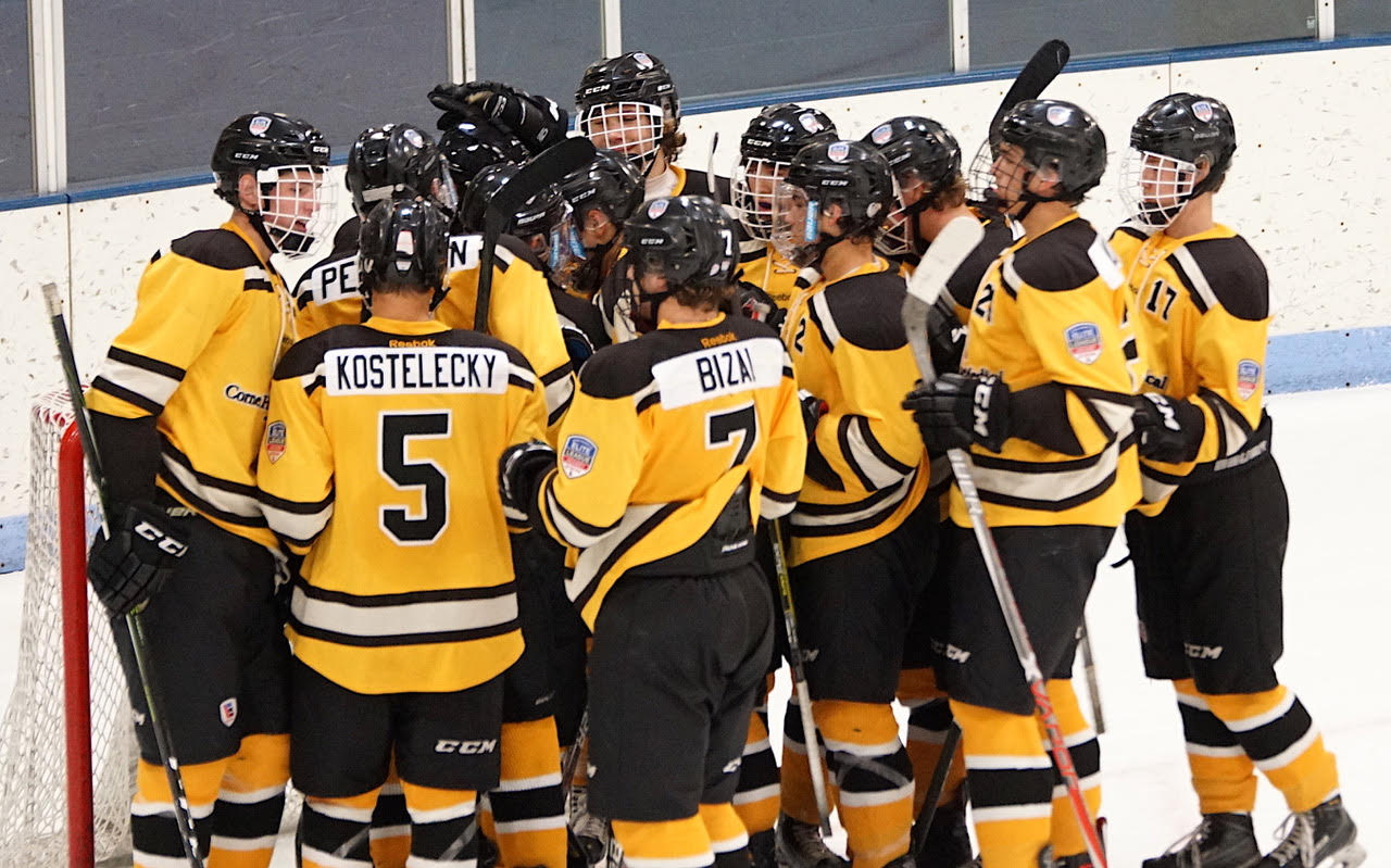 Team Northwest celebrates its 2-1 win over Great Plains on Sunday morning at New Hope Ice Arena. Credit: Peter Odney.