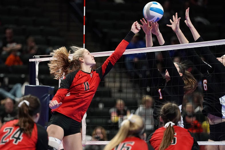 North Branch's Cianna Selbitschka (11) knocks the ball over the net against Marshall in the Class 2A state championship. Selbitschka was one of three Vikings named to this year's Class 2A all-tourney team. Star Tribune photo by Anthony Souffle