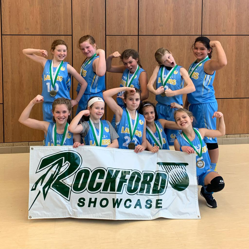Girls 5th Grade Gold Goof off with their hardware after taking 1st at Rockford Showcase