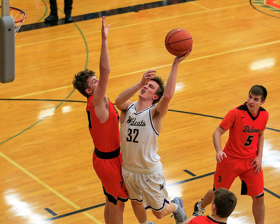Junior forward Connor Schwob powered past Delano's Trey Longstreet for two of his 17 second-half points in Waconia's 87-84 victory. Photo by Mark Hvidsten, SportsEngine