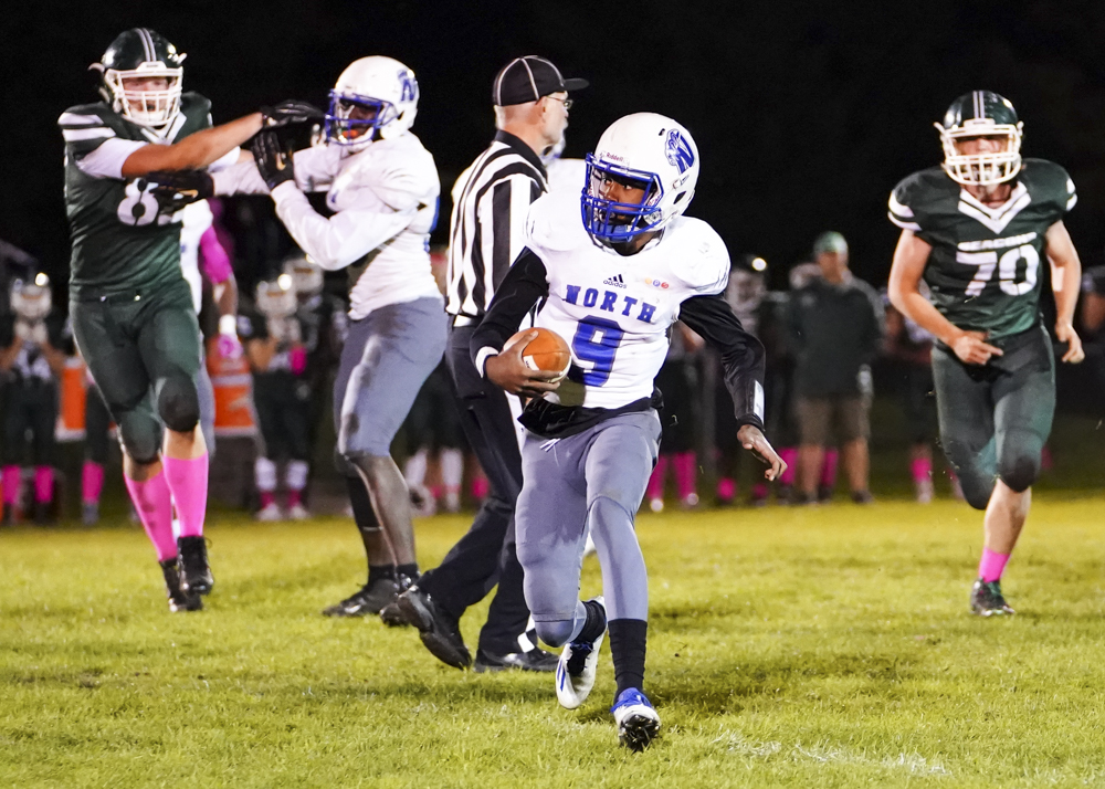 Minneapolis North junior quarterback Armon Dalton (9) rushes deep into the red-zone avoiding defenders as he leads his team to a 34-0 victory over Concordia Academy. Photo by Travis Ellison, SportsEngine