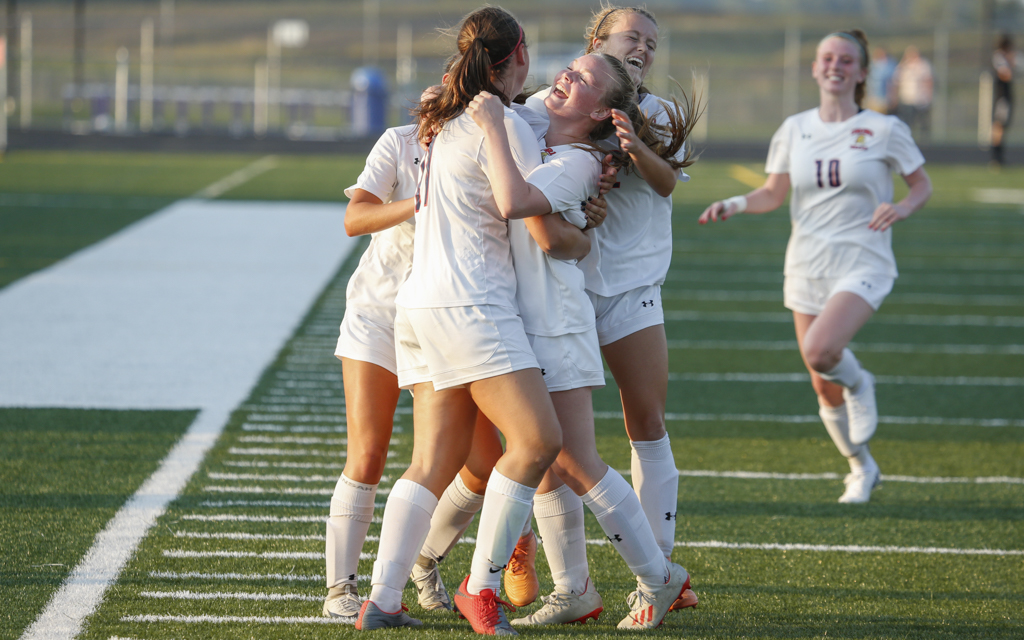 Orono teammates celebrate Anna Tesar's game-tying goal in the 77th minute of Tuesday evening's Wright County Conference match against Waconia. The Spartans and the Wildcats played to a 1-1 draw in Waconia. Photo by Jeff Lawler, SportsEngine