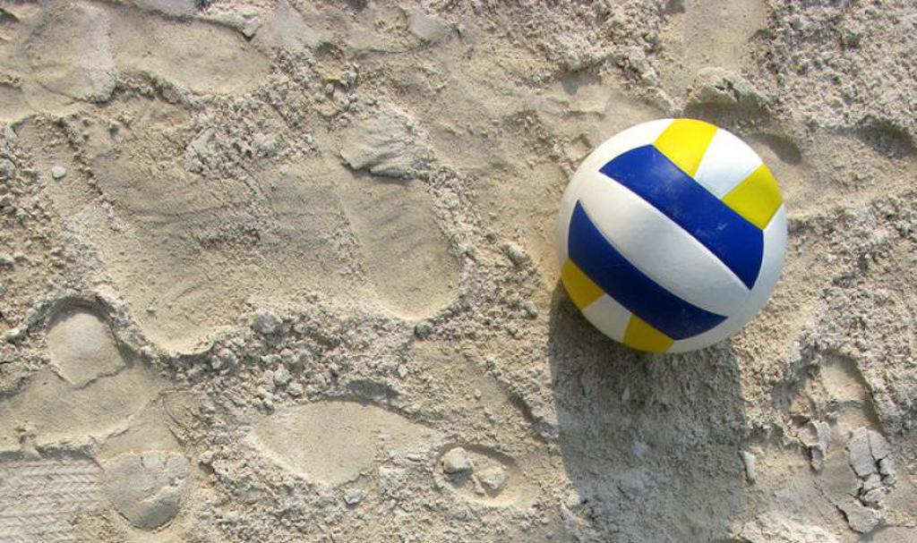 Sand volleyball coming soon. ball sitting in the sand