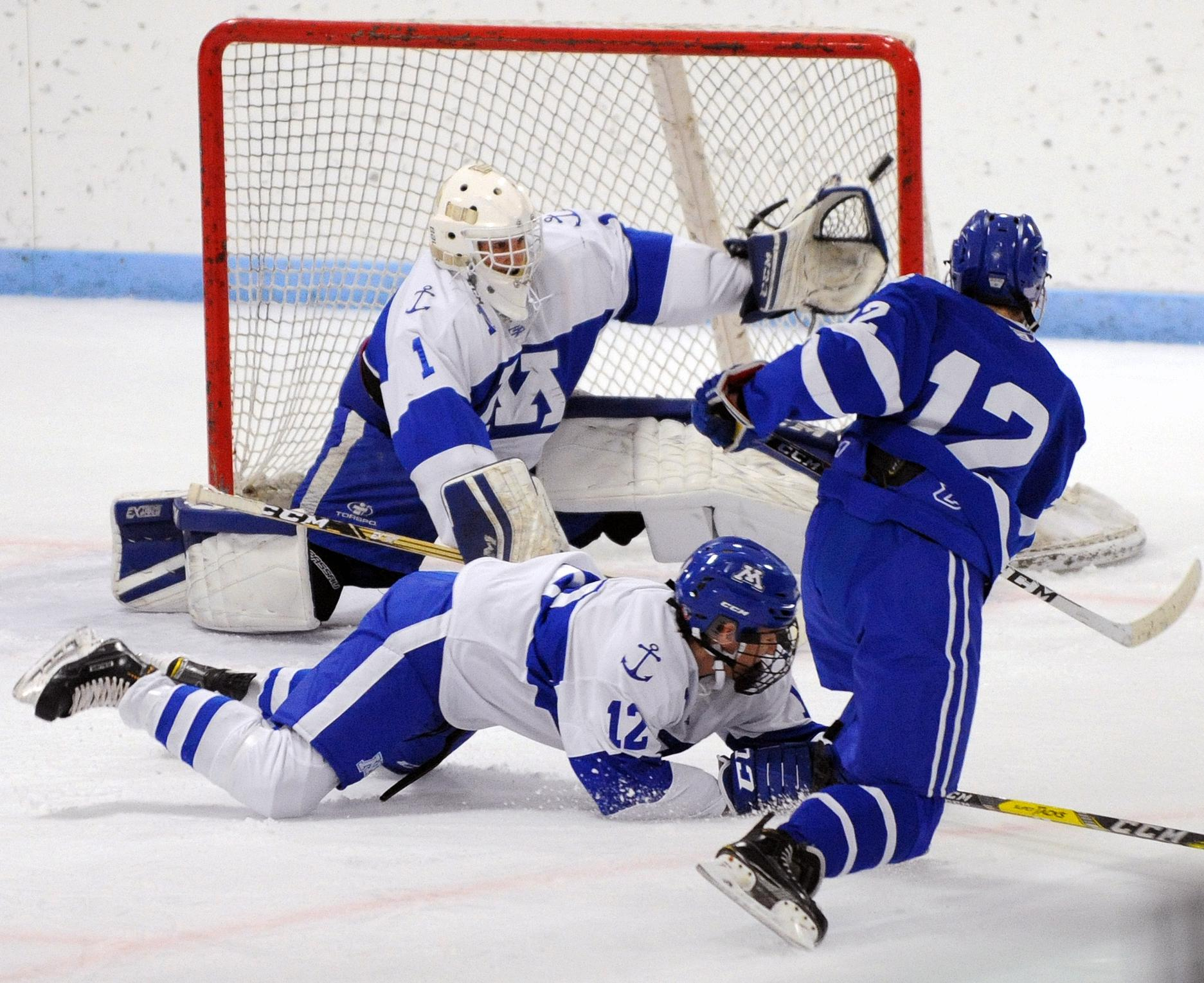Ryan O'Neill scores a first-period goal for St. Thomas Academy. Photo by Loren Nelson, SportsEngine