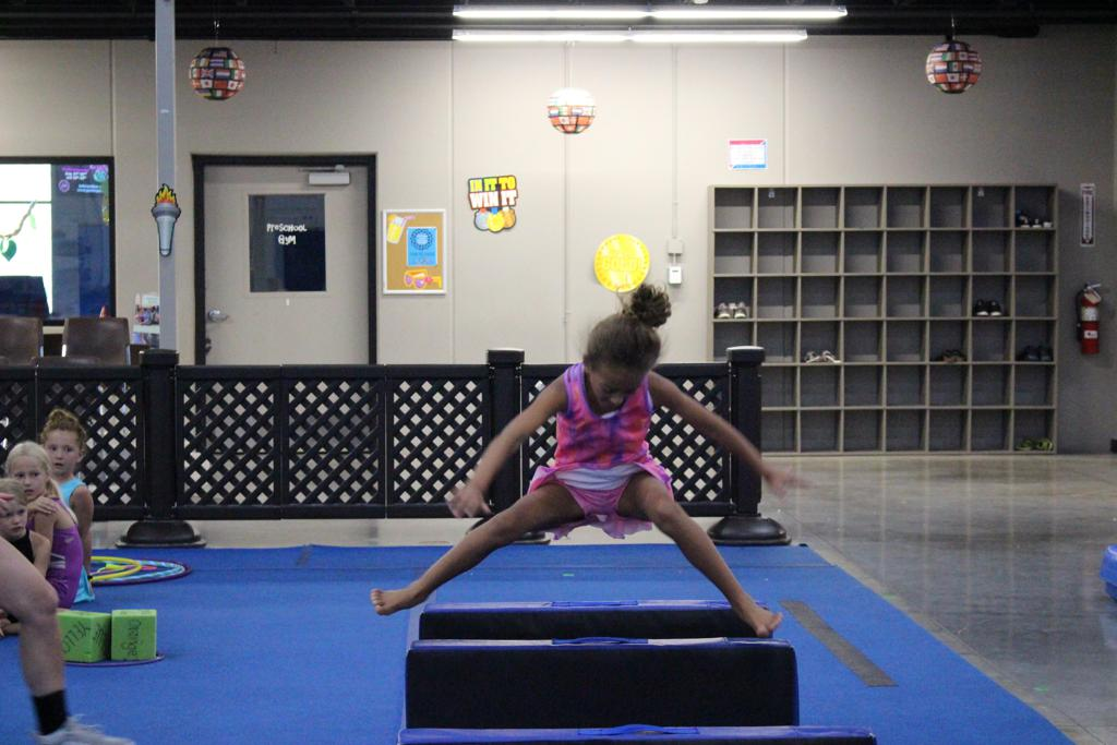 Camper learning how to do a handstand at camp