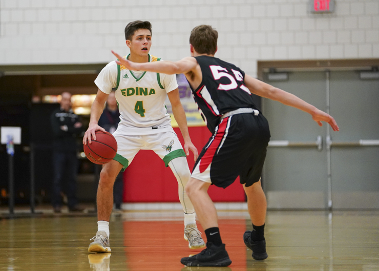 Edina senior guard Anders Nelson (4) brings the ball into the front court as Shakopee sophomore guard Will Cordes (55) plays close defense as the Hornets win 74-66.  Photo by Travis Ellison, SportsEngine