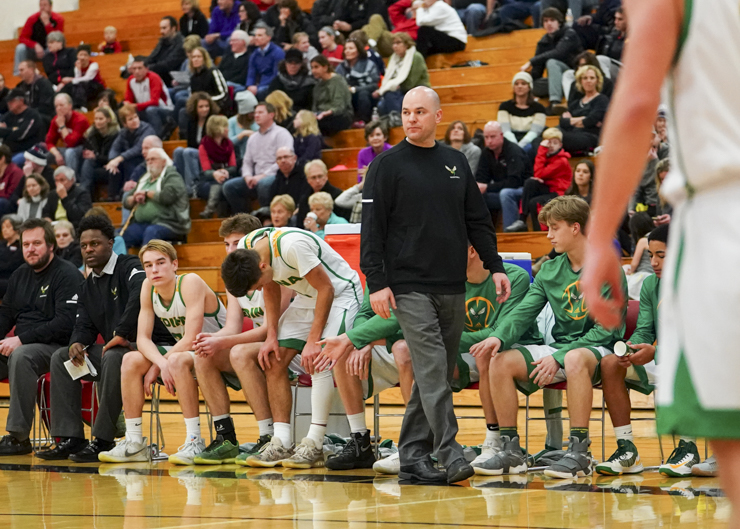 Edina head coach Joe Burger paces the sideline during a close scoring first half as Edina goes on to win 74-66. Photo by Travis Ellison, SportsEngine