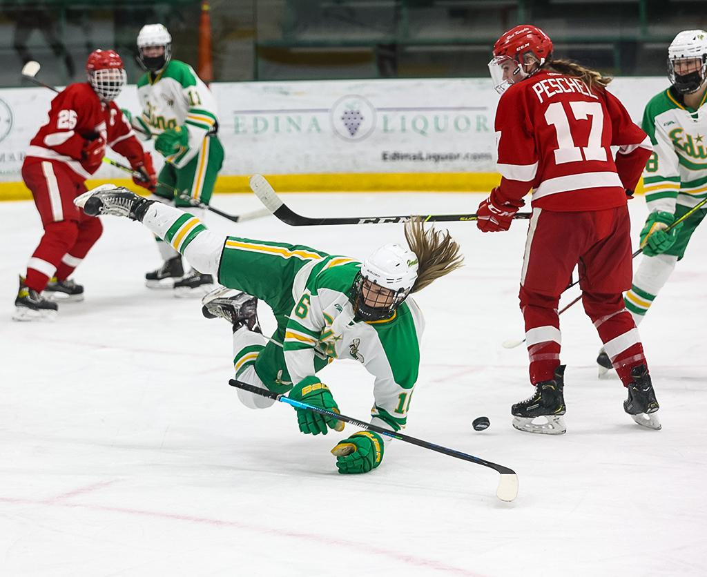 Emma Conner (16) is tripped at the end of the second period. Conner scored both of the Edina's goals in a 2-1 win over Class 2A, Section 6 rival Benilde-St. Margaret's on Thursday night. Photo by Cheryl A. Myers, SportsEngin