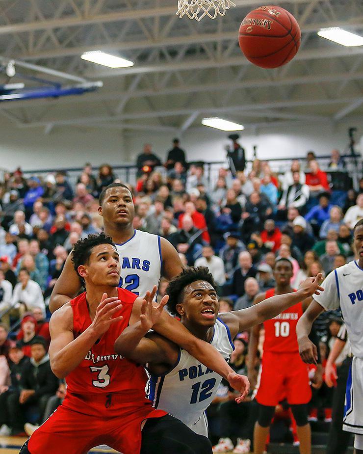 Minnehaha Academy's Terry Lockett (3) and North's Nasir El-Amin battle for a rebound. Photo by Mark Hvidsten, SportsEngine