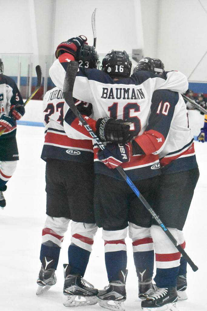 The 16U Pics gather after a goal.