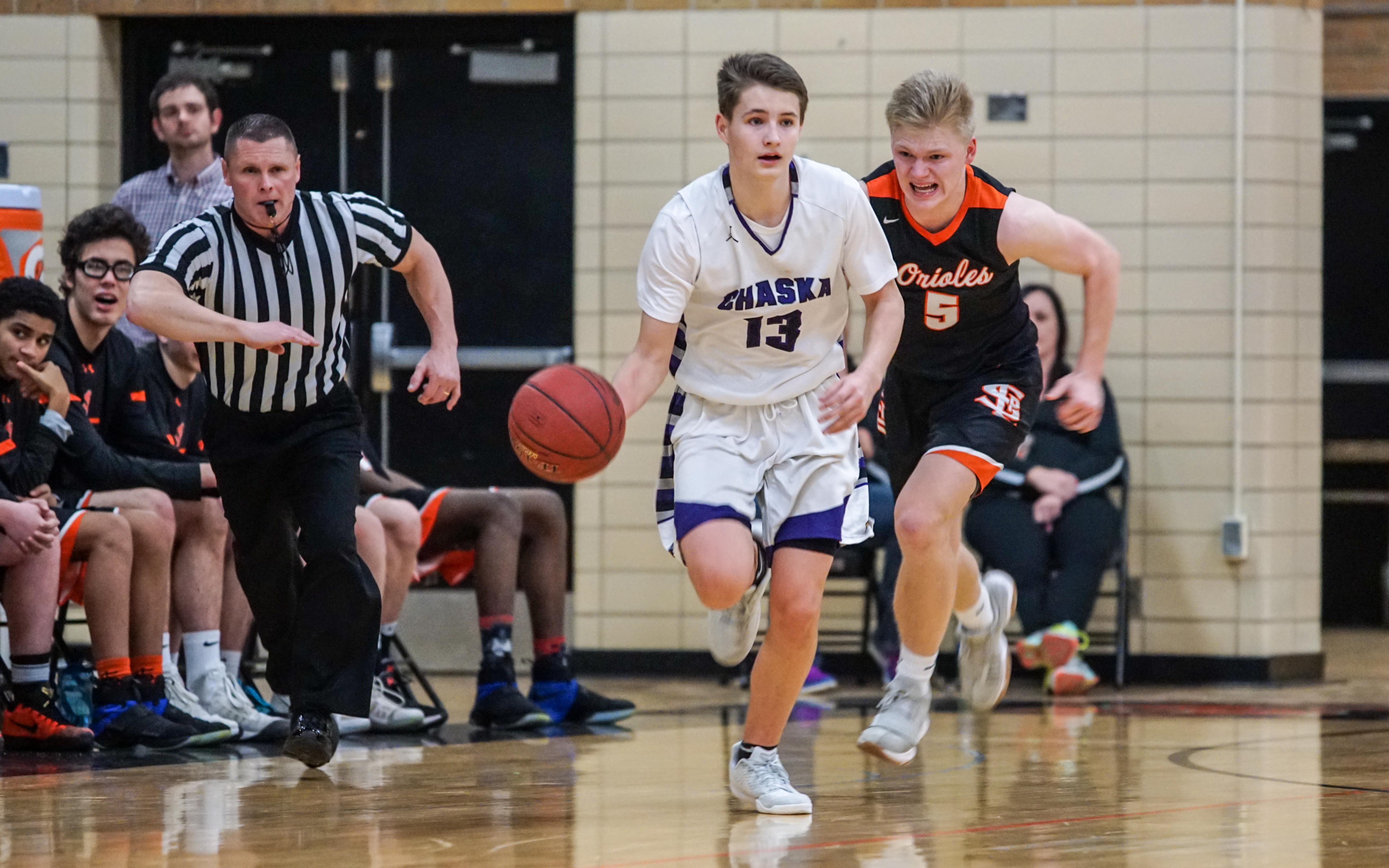 Chaska's Conner Krenos (13) pushes the ball down the court against St. Louis Park Feb 9. Krenos had a season high 34 points in the 92-68 Hawks victory. Photo by Korey McDermott, SportsEngine