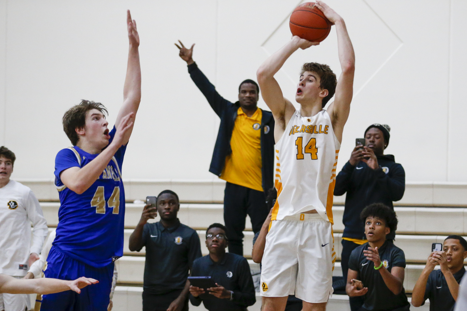 DeLaSalle's Cade Haskins (14) puts up the game-winning three-point shot at the buzzer to defeat Holy Angels 59-56 Friday night in Richfield. Haskins had a team-high 20 points for the Islanders. Photo by Jeff Lawler, SportsEngine
