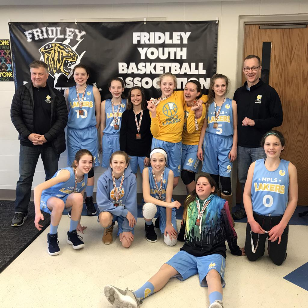 Girls 7th Grade Gold pose with their medals