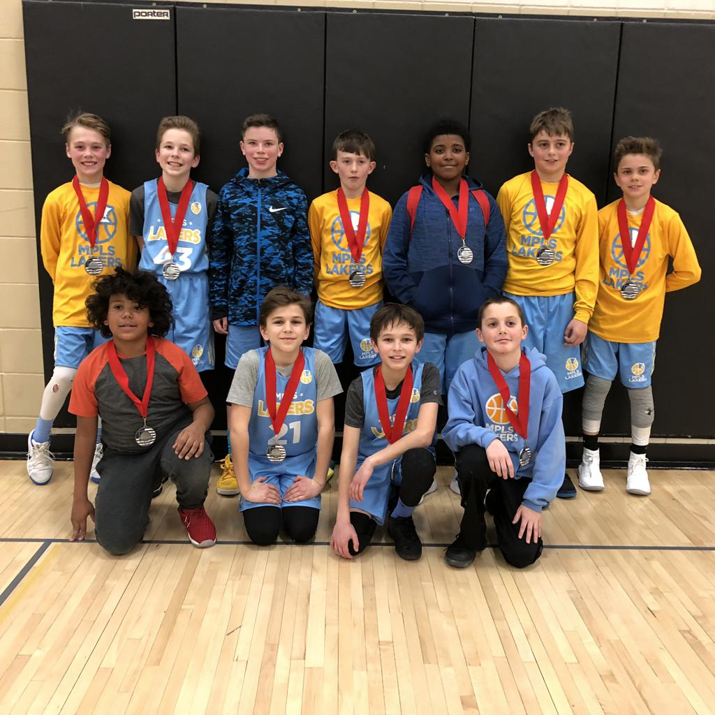 Boys 5th Grade Gold posing with their medals