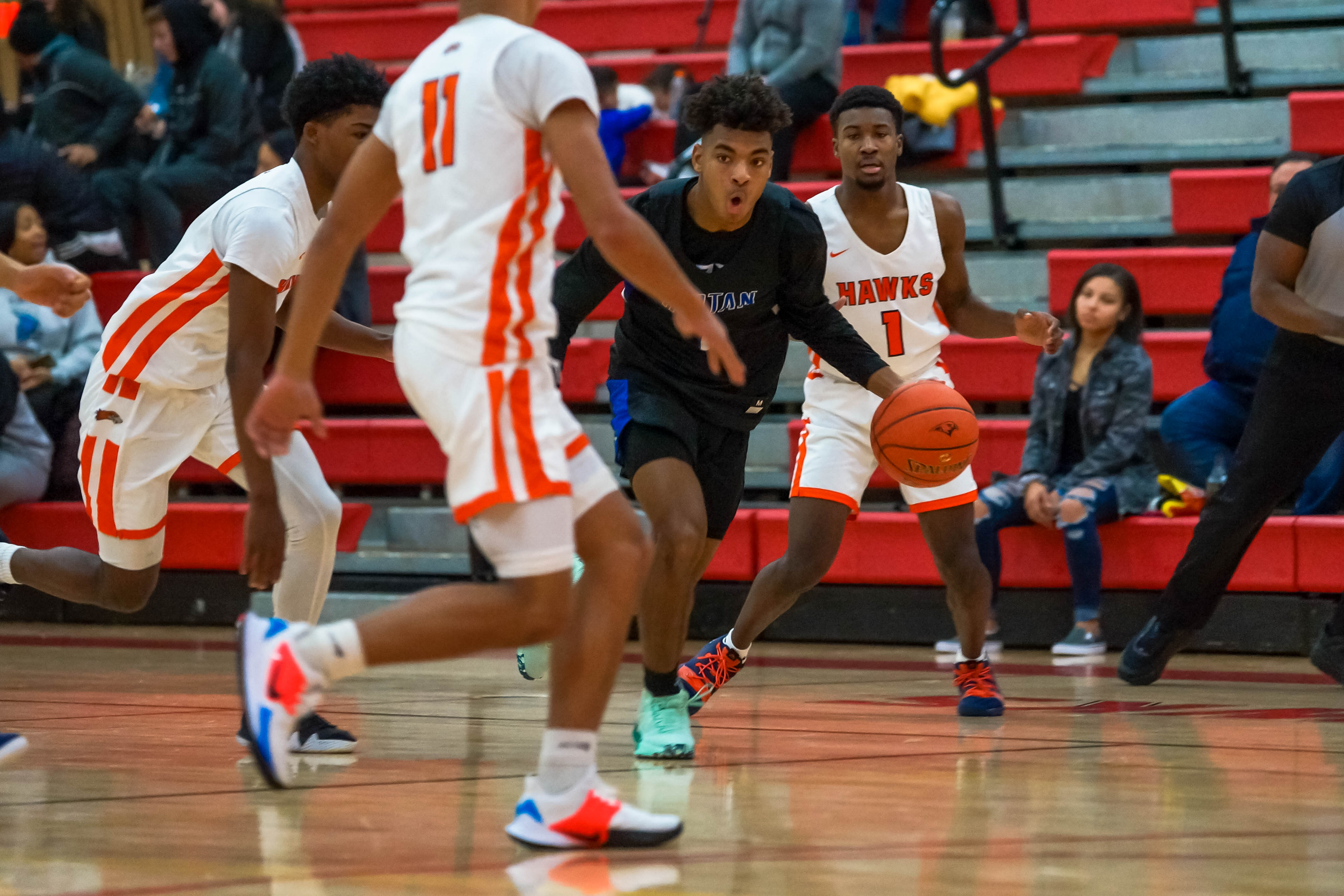 Tartan guard Dorian Singer (center) moves the ball up court against Robbinsdale Cooper Saturday in a 74-71 win for Tartan. Photo by Korey McDermott, SportsEngine