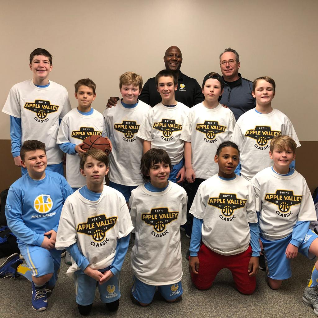 Minneapolis Lakers Boys 6th Grade White pose with their T-Shirts after becoming the Consolation champs at Apple Valley Classic