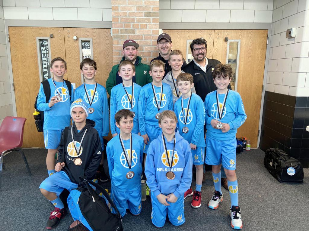 Mpls Lakers Youth Traveling Basketball Program Inc Boys 5th Grade White pose with their Medals after taking Third Place at the Roseville Winter Classic tournament in Roseville , MN