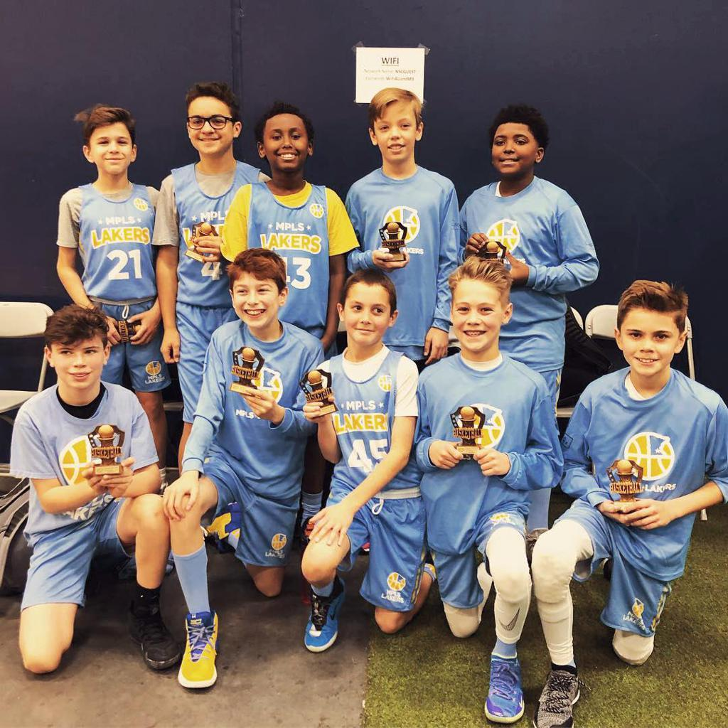 Boys 6th Grade Gold pose with their hardware after taking 3rd Place at Spring Lake Park Panther Classic