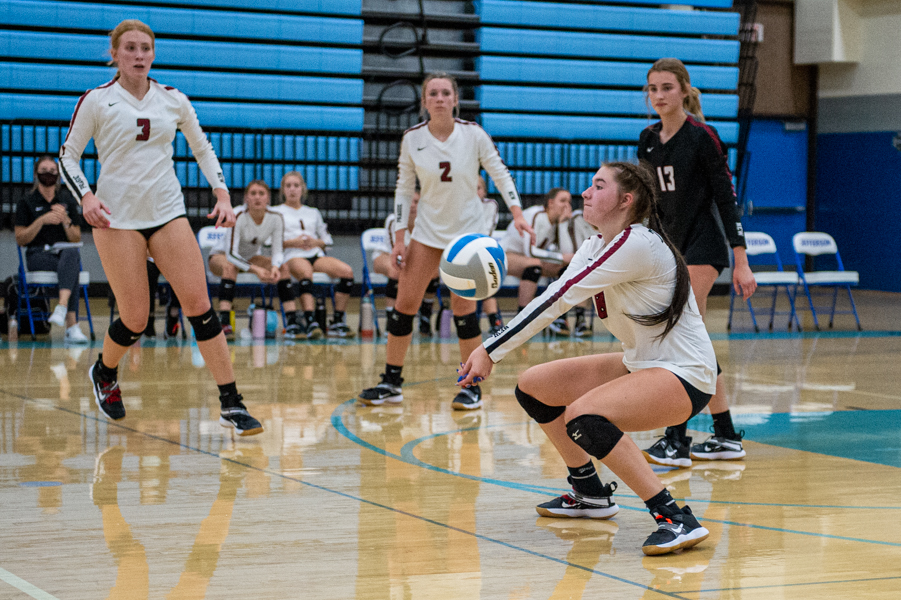 New Prague's Anna Molstad makes a save and keeps the ball in play in the second set Tuesday night. The Trojans scored a 3-1 victory at Metro West Conference rival Bloomington Jefferson 3-1. Photo by Earl J. Ebensteiner, SportsEngine