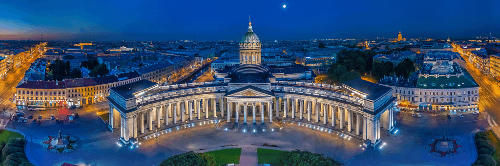 Wide angle image of Kazan Cathedral in St. Petersburg, Russia at night where streets and monuments are enlightened
