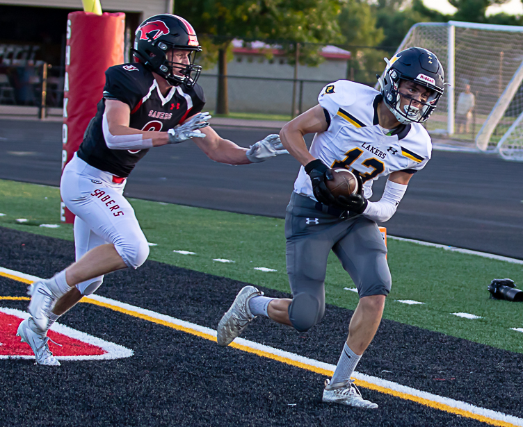 Prior Lake junior wide receiver Jake Anderson puts the Lakers up 6-0 against host Shakopee on Friday Night. The Lakers went out to defeat the Sabers 14-12. Photo by Gary Mukai, SportsEngine